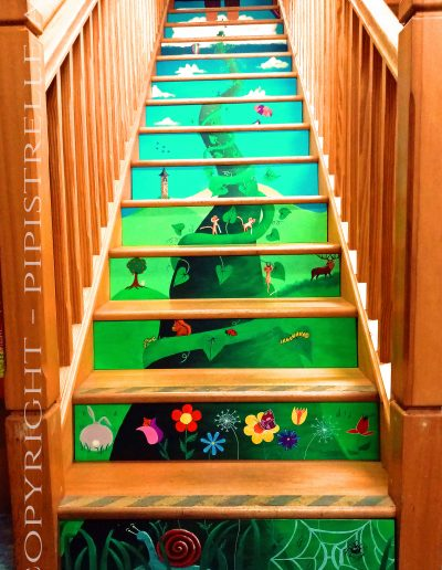 Astley Book Farm Beanstalk. Mural of a Beanstalk heading up the stairs to the Children's Hayloft at Astley Book Farm